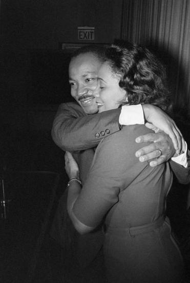 Martin Luther King, Jr. hugs his wife, Coretta, during a news conference following the announcement that he had been awarded the Nobel Peace Prize.